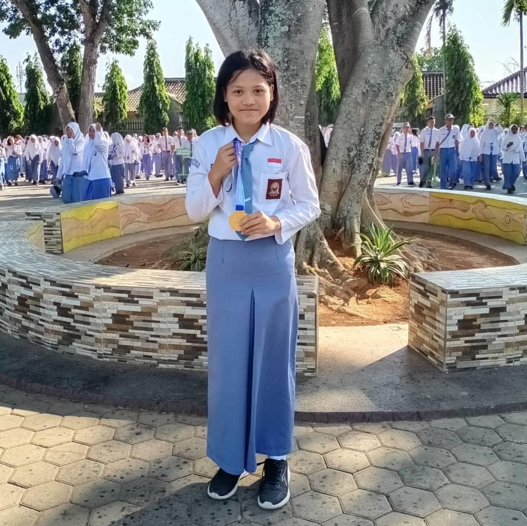 Mendali Emas Tinju Putri kelas 48 kg dalam Pekan Olahraga Wilayan (Porwil) X Sumatera
